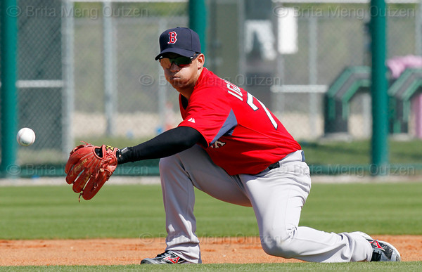 FORT MYERS, FL, Feb. 22, 2012: With his left hand behind his back, Boston Red Sox shortstop Jose Iglesias prepares to field a ground ball during an infield drill at Spring Training. (Brita Meng Outzen/Boston Red Sox)