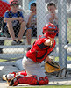 FORT MYERS, FL, Feb. 22, 2012: As young fans watch, Boston Red Sox catcher Daniel Butler tosses the baseball to a pitcher covering home plate during a pitchers' fielding practice drill at Spring Training workouts. (Brita Meng Outzen/Boston Red Sox)