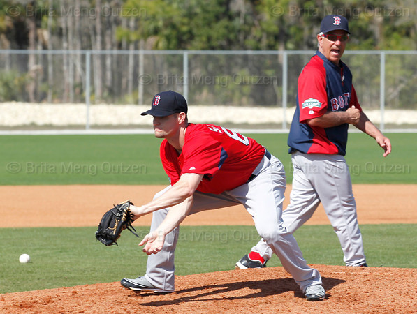 FORT MYERS, FL, Feb. 22, 2012: Boston Red Sox manager Bobby Valentine, right, shouts encouragement to pitcher Chorey Spoone during a pitchers' fielding practice drill at Spring Training workouts. (Brita Meng Outzen/Boston Red Sox)