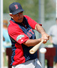 FORT MYERS, FL, Feb. 22, 2012: Boston Red Sox manager Bobby Valentine hits ground balls during infield practice at Spring Training workouts. (Brita Meng Outzen/Boston Red Sox)
