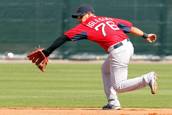 FORT MYERS, FL, Feb. 22, 2012: Boston Red Sox shortstop Jose Iglesias fields a ground ball hit by Red Sox manager Bobby Valentine during infield practice at Spring Training. (Brita Meng Outzen/Boston Red Sox)