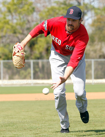 FORT MYERS, FL, Feb. 22, 2012: Boston Red Sox pitcher Andrew Miller flips the baseball to the catcher covering home plate during pitchers' fielding practice drills at Spring Training workouts. (Brita Meng Outzen/Boston Red Sox)