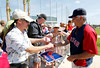 FORT MYERS, FL, Feb. 22, 2012: Boston Red Sox manager Bobby Valentine, right, signs autographs for fans following workouts at Spring Training. (Brita Meng Outzen/Boston Red Sox)
