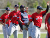 FORT MYERS, FL, Feb. 22, 2012: Boston Red Sox designated hitter David Ortiz, second from right, laughs as he warms up with teammates, from left, Ryan Kalish, Alex Hassan and Jose Iglesias during an informal workout at Spring Training. Red Sox position players are due to report Thursday. (Brita Meng Outzen/Boston Red Sox)