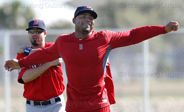 FORT MYERS, FL, Feb. 22, 2012: Boston Red Sox left fielder Carl Crawford, right, smiles as he and teammate Jason Repko stretch on the field before an informal workout. Crawford, who is recovering from offseason wrist surgery, reported early to Spring Training. (Brita Meng Outzen/Boston Red Sox)