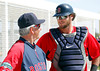 FORT MYERS, FL, Feb. 23, 2012: Boston Red Sox manager Bobby Valentine, left, and catcher Jarrod Saltalamacchia talk after Saltalamacchia catches pitcher Daniel Bard's throwing live batting practice at Spring Training workouts. (Brita Meng Outzen/Boston Red Sox)