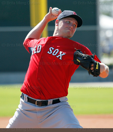 FORT MYERS, FL, Feb. 23, 2012: Boston Red Sox pitcher Alex Wilson throws live batting practice to Red Sox minor league hitters at Spring Training workouts. (Brita Meng Outzen/Boston Red Sox)