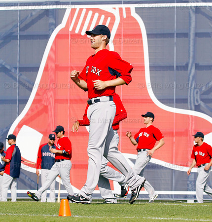 FORT MYERS, FL, Feb. 23, 2012: Boston Red Sox pitcher Daniel Bard and other Red Sox pitchers and catchers warm up on the agility field at the beginning of Spring Training workouts. (Brita Meng Outzen/Boston Red Sox)