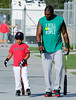 FORT MYERS, FL, Feb. 23, 2012: Boston Red Sox  designated hitter David Ortiz, right, and son D'Angelo walk back to the clubhouse after hitting in the indoor batting cages at Spring Training workouts. (Brita Meng Outzen/Boston Red Sox)