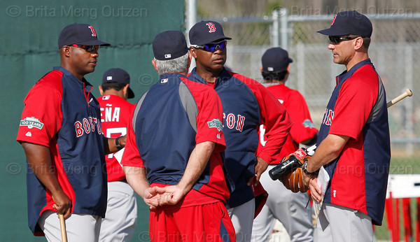 FORT MYERS, FL, Feb. 23, 2012: From left, Boston Red Sox first base coach Alex Ochoa, manager Bobby Valentine, third base coach Jerry Royster and bench coach Tim Bogar talk on the practice field during  Spring Training workouts. (Brita Meng Outzen/Boston Red Sox)