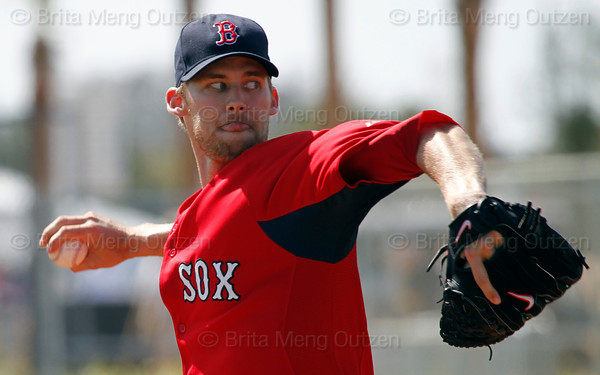 FORT MYERS, FL, Feb. 23, 2012: Boston Red Sox pitcher Daniel Bard throws live batting practice to Red Sox minor league hitters at Spring Training workouts. (Brita Meng Outzen/Boston Red Sox)