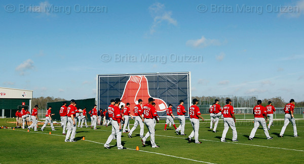 FORT MYERS, FL, Feb. 23, 2012: Boston Red Sox pitchers and catchers warm up on the agility field to begin their Spring Training workout. (Brita Meng Outzen/Boston Red Sox)