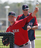 FORT MYERS, FL, Feb. 23, 2012: Boston Red Sox pitcher Jon Lester, left, throws live batting practice to Red Sox minor league hitters as minor league pitching coordinator Ralph Treuel watches during  Spring Training workouts. (Brita Meng Outzen/Boston Red Sox)