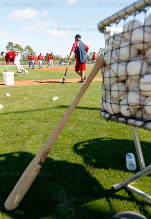 FORT MYERS, FL, Feb. 23, 2012: Boston Red Sox manager Bobby Valentine, second from left, watches Red Sox pitchers perform fielding drills on the practice fields during Spring Training workouts. (Brita Meng Outzen/Boston Red Sox)