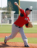FORT MYERS, FL, Feb. 23, 2012: Boston Red Sox pitcher Andrew Bailey delivers a pitch while throwing live batting practice to Red Sox minor league hitters at Spring Training workouts. (Brita Meng Outzen/Boston Red Sox)