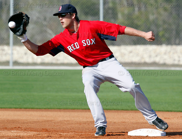 FORT MYERS, FL, Feb. 23, 2012: Boston Red Sox first baseman Lars Anderson catches a throw from a pitcher during pitchers' fielding practice at Spring Training workouts. (Brita Meng Outzen/Boston Red Sox)