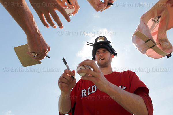 FORT MYERS, FL, Feb. 23, 2012: Boston Red Sox pitchers Daniel Bard signs autographs for fans following his Spring Training workout. (Brita Meng Outzen/Boston Red Sox)