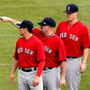 FORT MYERS, FL, Feb. 25, 2012: Boston Red Sox third baseman Kevin Youkilis, center, points out practice fields to center fielder Jacoby Ellsbury, left, as pitcher Andrew Bailey watches as the Red Sox begin their first full squad Spring Training workout. (Brita Meng Outzen/Boston Red Sox)