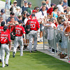 FORT MYERS, FL, Feb. 25, 2012: Boston Red Sox players, from left, Pedro Ciriaco, Adrian Gonzalez, Dustin Pedroia and Kevin Youkilis walk by fans on the way to the practice fields at the team's first full squad Spring Training workout. (Brita Meng Outzen/Boston Red Sox)