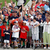 FORT MYERS, FL, Feb. 25, 2012: Boston Red Sox fans cheer at the start of the team's first full squad Spring Training workout. (Brita Meng Outzen/Boston Red Sox)