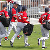 FORT MYERS, FL, Feb. 25, 2012: From left, Boston Red Sox outfielder Josh Kroeger, manager Bobby Valentine, Darnell McDonald and Jacoby Ellsbury walk to the practice field for the first full squad Spring Training workout. (Brita Meng Outzen/Boston Red Sox)