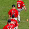 FORT MYERS, FL, Feb. 25, 2012: From top, Boston Red Sox infielder Nick Punto, outfielder Cody Ross, second baseman Dustin Pedroia and outfielder Ryan Sweeney warm up on the agility field before the team's first full squad Spring Training workout. (Brita Meng Outzen/Boston Red Sox)