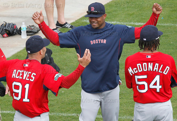 FORT MYERS, FL, Feb. 25, 2012: From left, Boston Red Sox pitcher Alfredo Aceves, left fielder Carl Crawford and outfielder Darnell McDonald chat on the field during warmups before the team's first full squad Spring Training workout. (Brita Meng Outzen/Boston Red Sox)