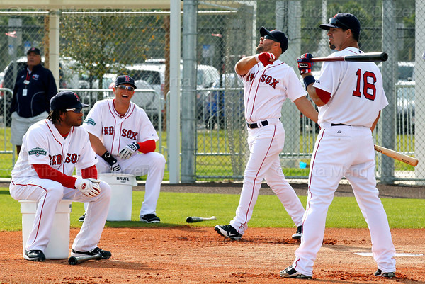FORT MYERS, FL, Feb. 26, 2012: Boston Red Sox outfielder Cody Ross, second from right, watches the flight of his batted ball, hit on a flip by Ryan Sweeney, second from left, as Jason Repko, right, and Darnell McDonald await their turn to hit during a drill to outfielders during a fielding drill at Spring Training. (Brita Meng Outzen/Boston Red Sox)