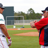 FORT MYERS, FL, Feb. 26, 2012: Boston Red Sox manager Bobby Valentine, right, gives catcher Luis Exposito some hitting advice live batting practice at Spring Training. (Brita Meng Outzen/Boston Red Sox)