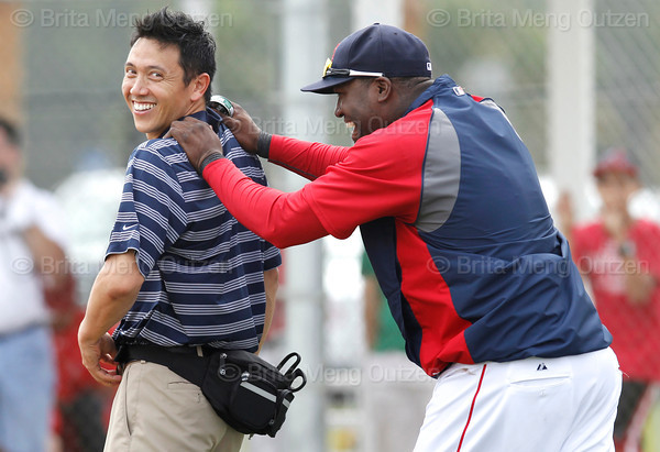 FORT MYERS, FL, Feb. 26, 2012: Boston Red Sox designated hitter  David Ortiz, right, has some fun with Red Sox assistant trainer Masai Takahashi during batting practice at Spring Training. (Brita Meng Outzen/Boston Red Sox)