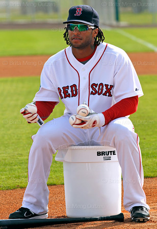 FORT MYERS, FL, Feb. 26, 2012: Boston Red Sox outfielder Darnell McDonald flips a baseball for teammate Jason Repko to hit to other outfielders during a fielding drill at Spring Training. (Brita Meng Outzen/Boston Red Sox)