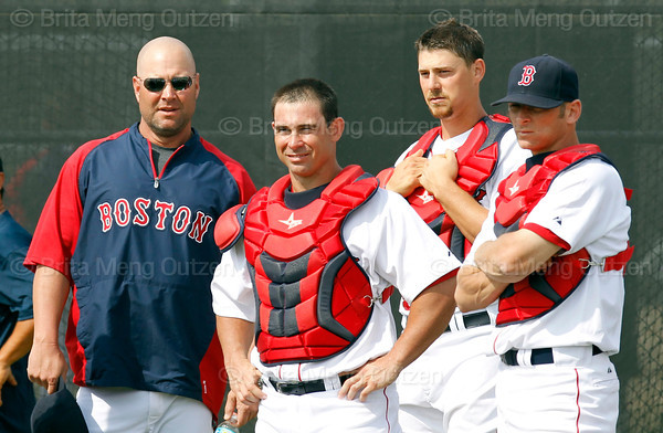 FORT MYERS, FL, Feb. 26, 2012: From left, Boston Red Sox catching coordinator Chad Epperson and catchers Daniel Butler, Ryan Lavarnway and Max St. Pierre watch pitchers warm up in the bullpen before throwing live batting practice at Spring Training. (Brita Meng Outzen/Boston Red Sox)