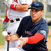 FORT MYERS, FL, Feb. 26, 2012: Boston Red Sox center fielder Jacoby Ellsbury flips the baseball for teammate Josh Kroeger, not shown, to hit during an outfield drill at Spring Training. (Brita Meng Outzen/Boston Red Sox)