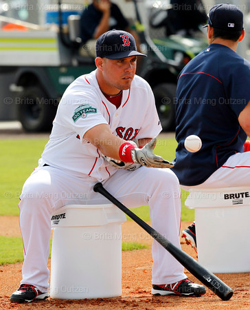 FORT MYERS, FL, Feb. 26, 2012: Boston Red Sox outfielder Juan Carlos Linares, left, flips a baseball for teammate Che-Hsuan Lin, not shown, to hit during an outfield drill at Spring Training. (Brita Meng Outzen/Boston Red Sox)