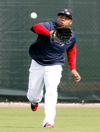 FORT MYERS, FL, Feb. 26, 2012: Boston Red Sox left fielder Carl Crawford prepares to catch a fly ball hit by a teammate during an outfield drill at Spring Training. (Brita Meng Outzen/Boston Red Sox)