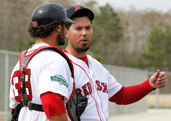 FORT MYERS, FL, Feb. 26, 2012: Boston Red Sox pitcher Josh Beckett, right, talks with catcher Jarrod Saltalamacchia after throwing live batting practice to teammates Dustin Pedroia and Adrian Gonzalez at Spring Training workouts. (Brita Meng Outzen/Boston Red Sox)