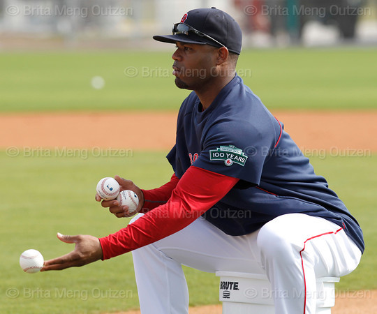 FORT MYERS, FL, Feb. 26, 2012: Boston Red Sox left fielder Carl Crawford flips the baseball for Alex Hassan, not shown, to hit during an outfield drill at Spring Training. (Brita Meng Outzen/Boston Red Sox)