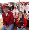 FORT MYERS, FL, March 4, 2012: A young fan with his father enjoys a pregame ice cream cone while seated at a shaded picnic table at Fenway South before the JetBlue Park Opening Day game between the Boston Red Sox and Minnesota Twins. (Brita Meng Outzen/Boston Red Sox)