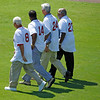 FORT MYERS, FL, March 4, 2012: From left, Boston Red Sox legends Carl Yastrzemski, Jim Rice, Dwight Evans and Luis Tiant walk across the outfield during the pregame ceremony celebrating Opening Day at JetBlue Park at Fenway South, the new Red Sox spring training home. (Brita Meng Outzen/Boston Red Sox)