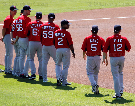 FORT MYERS, FL, March 4, 2012: Boston Red Sox minor league players line the infield for the pregame ceremony before the game between the Red Sox and Minnesota Twins on Opening Day at JetBlue Park at Fenway South. (Brita Meng Outzen/Boston Red Sox)