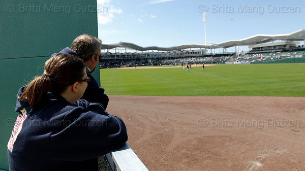 FORT MYERS, FL, March 4, 2012: Two Boston Red Sox fans check out the outfield view from the grass seating area at JetBlue Park at Fenway South before the Boston Red Sox game against the Minnesota Twins on Opening Day. (Brita Meng Outzen/Boston Red Sox)