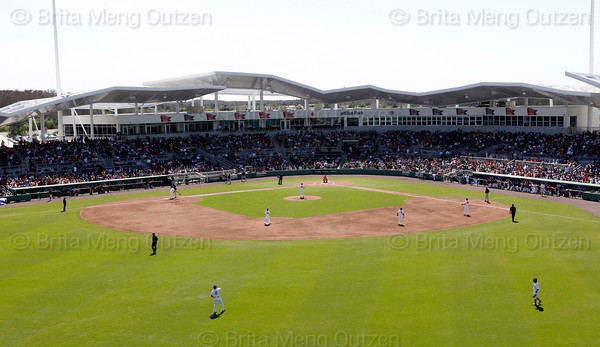 FORT MYERS, FL, March 4, 2012: The Boston Red Sox warm up on the field before the top of the second inning of the game against the Minnesota Twins at JetBlue Park at Fenway South. (Brita Meng Outzen/Boston Red Sox)