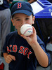 FORT MYERS, FL, March 4, 2012: A young fan holds up a baseball he received during batting practice before the game between the Boston Red Sox and Minnesota Twins at JetBlue Park at Fenway South on Opening Day. (Brita Meng Outzen/Boston Red Sox)