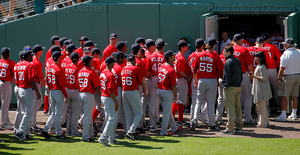 FORT MYERS, FL, March 4, 2012: Boston Red Sox minor league players return to the clubhouse after participating in the pregame ceremony on Opening Day at JetBlue Park at Fenway South. (Brita Meng Outzen/Boston Red Sox)