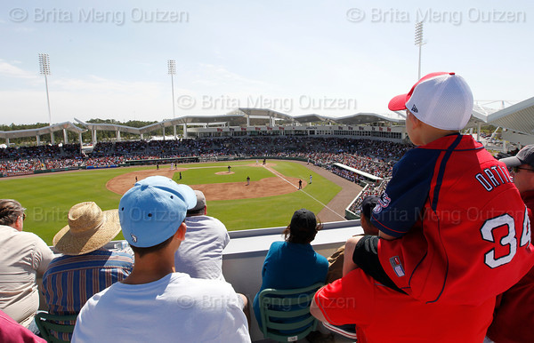 FORT MYERS, FL, March 4, 2012: Fans watch the Minnesota Twins warm up on the field before the bottom of the first inning of their game against the Boston Red Sox from the upper deck of the Green Monster at JetBlue Park at Fenway South. (Brita Meng Outzen/Boston Red Sox)