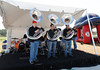 FORT MYERS, FL, March 4, 2012: A trio of tubas entertain fans before the game between the Boston Red Sox and Minnesota Twins on Opening Day at JetBlue Park at Fenway South. (Brita Meng Outzen/Boston Red Sox)