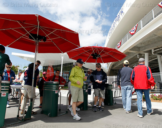 FORT MYERS, FL, March 4, 2012: Boston Red Sox fans pass through the turnstiles at Fenway South before the Red Sox game against the Minnesota Twins on Opening Day. (Brita Meng Outzen/Boston Red Sox)