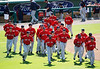 FORT MYERS, FL, March 4, 2012: Boston Red Sox minor league players run back to the clubhouse after participating in the pregame ceremony on Opening Day at JetBlue Park at Fenway South. (Brita Meng Outzen/Boston Red Sox)