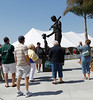 FORT MYERS, FL, March 4, 2012: Boston Red Sox fans visit the statue of Ted Williams and a Jimmy Fund patient prior to the game between the Boston Red Sox and Minnesota Twins on Opening Day at JetBlue Park at Fenway South. (Brita Meng Outzen/Boston Red Sox)