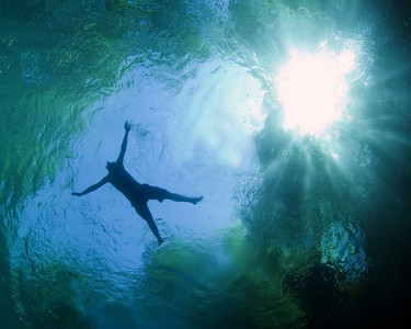 A swimmer enjoys the cool, clear waters of a natural spring at Madison Blue State Park, Florida. Cave divers like photographer Jill Heinerth, swim the watery labyrinths below the sunlit waters. Photo: Jill Heinerth
